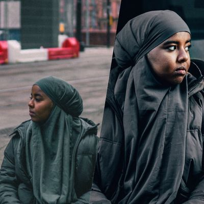 Two photos next to each other, separated by a slanted line down the middle. On the left, Ebyan looks off into the distance while sat down on a street in Manchester city centre. On the right she is shown in close-up, facing the opposite way.