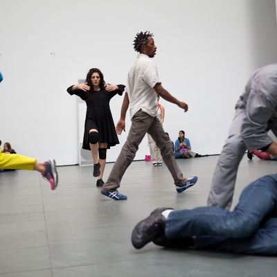 A group of dancers in a rehearsal space
